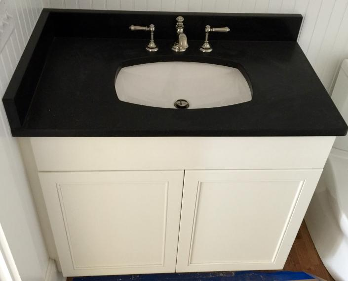 This is a small vanity that we made to go to St. Johns Island, SC. This door style is a 91 and it is painted Pure White.