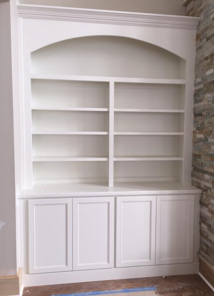 [Image: This is a cabinet next to a beautiful fire place. There is actually a TV hidden in the bottom of this unit. It has a remote that flips up a cutout in the top of the wood top and the TV raises up out of the cabinet. This is a number 91 door style and it is painted Pure White.]