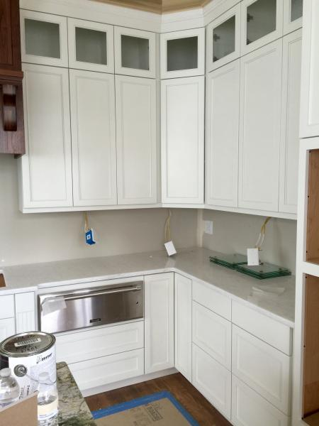 This is the kitchen perimeter cabinets. Door style is a number 91, and they are painted Pure White.