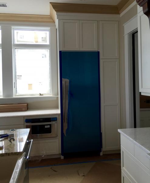 [Image: This is the kitchen perimeter cabinets. Door style is a number 91, and they are painted Pure White.]
